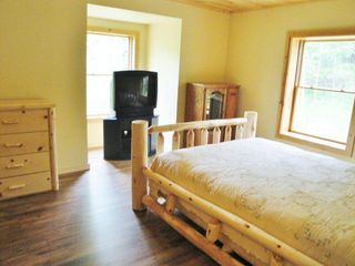 Burt Lake cabin photo - Third bedroom with Queen bed, watch TV or cuddle up and read a good book...