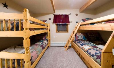 "Three Bunk Rooms with 10 bunk beds in total allow you to ""rack and stack""!!"