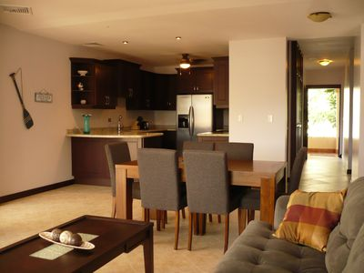 An open layout features a spacious kitchen and dining/lounging area.