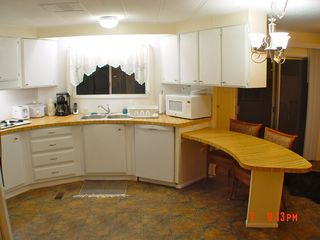 Green Valley mobile home photo - Kitchen with dishwasher,microwave and seating for 2 or more