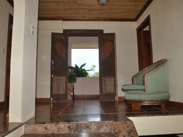 Upstairs foyer with outside patio to sit and view the volcano