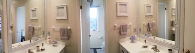 Bright guest bathroom features separate shower area and convenient double sinks