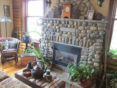 Tumble Down living room and field stone gas fireplace.