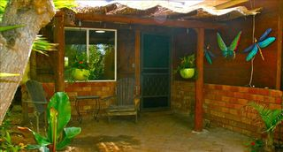 Cardiff by the Sea cottage photo - Patio with tropical plants, a barbeque, and west sunset skies