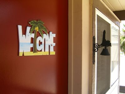 The sign on the front door welcomes you to the beach!! It's time for FUN!!