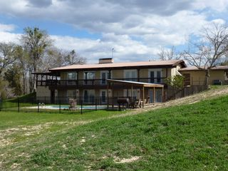 Lampasas house photo - Back view of the house with the new pool fence