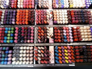 Even the nail polish on display at a cosmetics store is artfully arranged.