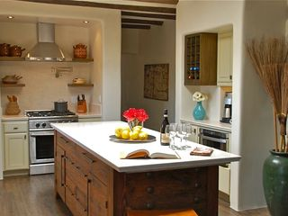 Santa Fe house photo - Stone counter tops and cypress floors.