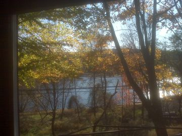 Lake view from front picture window in autumn.
