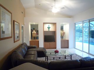 Family room opening on pool area - Naples house vacation rental photo
