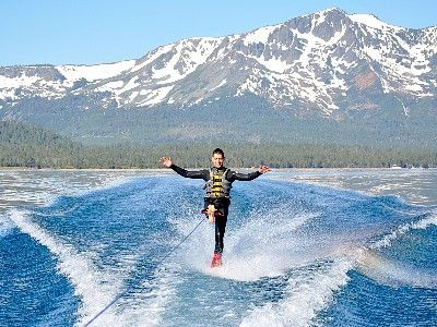 Springtime waterskiing w/ Mt. Tallac- and its trademark cross- in the background