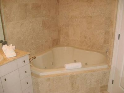 Travertine Tile and Garden-Size Jetted Tub in Master Bath