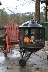 Estes Park cabin photo - Cozy Log rocking chairs by the firepit on those COOL Estes Park summer eves.