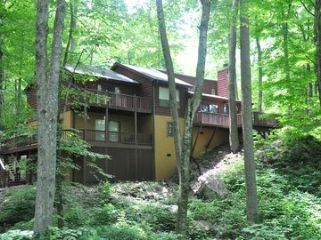 Maggie Valley house rental - View of the back of the house from the stream. All decks overlook the streams