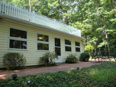 Anderson house rental - brick patio, table/chairs and gas grill off sunroom