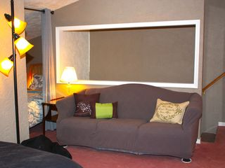 Crystal Mountain, Thompsonville lodge photo - Pullout sofa side A with full sized bed in loft area.
