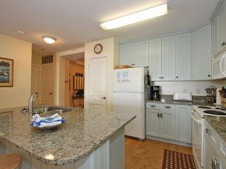 Isle of Palms condo photo - granite eating bar for 2-great kid space