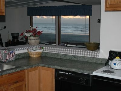 Kitchen opens to living room revealing the beautiful view out to the ocean.