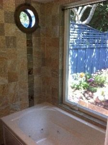 Bathroom with 8 Jet Jacuzzi & Window to the Garden