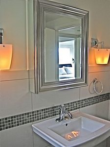 Hand blow glass fixtures & mirrored vanity downstairs