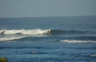 Outer reef surf break by house