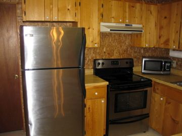Appliances include coffee maker, blender, toaster. Dishes and utensils