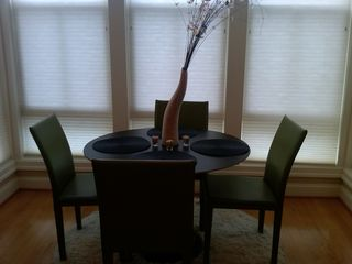 Logan Circle condo photo - Modern dining area features Saarinen-inspired table & leather dining chairs.
