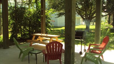 Galveston house rental - View of downstairs area with Oak tree and large yard area