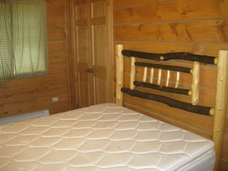 Hammond cabin photo - Hickory headboard with queen size bed