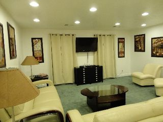 Living room with Flat Screen TV - plenty of seating for a large group! - Gulfport house vacation rental photo
