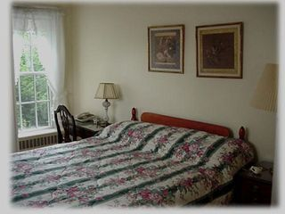 Bedroom 1 with queen bed and small attached bath - Stowe house vacation rental photo