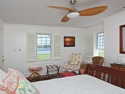 The Chesapeake queen bedroom has 3 windows two with great water views.