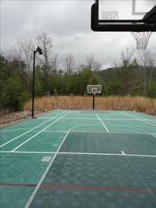 Sport Court with lights, basketball goals, tennis, volleyball or badminton net.
