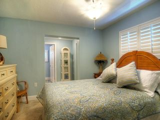 Cocoa Beach house photo - Room with queen bed, adjoining bath, and ocean accessible side door