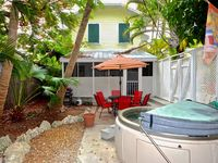 Tropical Hideaway-  2 BR Condo w/ Hot Tub & Lush Surroundings! Close To Beach