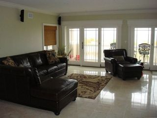 Long Beach condo rental - Living Room with gas burning fire place, flat screen tv and oceanfront terrace