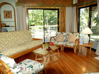 Pahoa cottage photo - Livng room with futon sofa looking towards side lanai