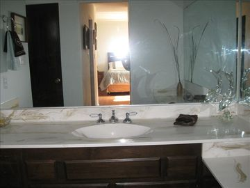 master bathroom, large tub, linen closet, vanity area