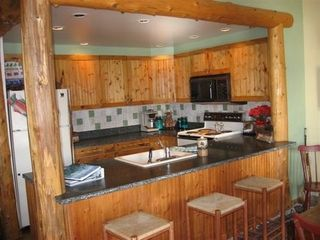 Lake Placid condo photo - Kitchen-granite counters,bar seating,fully equiped