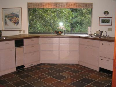 Kitchen with view to outside garden and oak trees