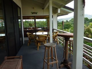 Princeville house photo - Upper Lanai with Dining Room in Background