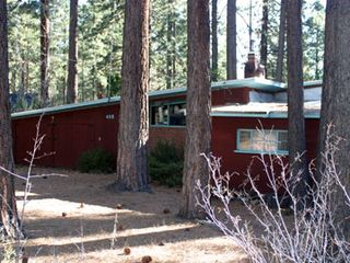 Lake Village house photo - Redwood home nestled in the pines