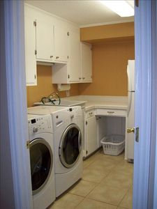 Laundry room with Modern Appliances and Extra Refrigerator