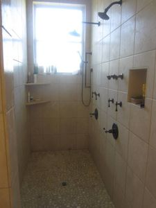 Master (dual) shower, all naturl stone.