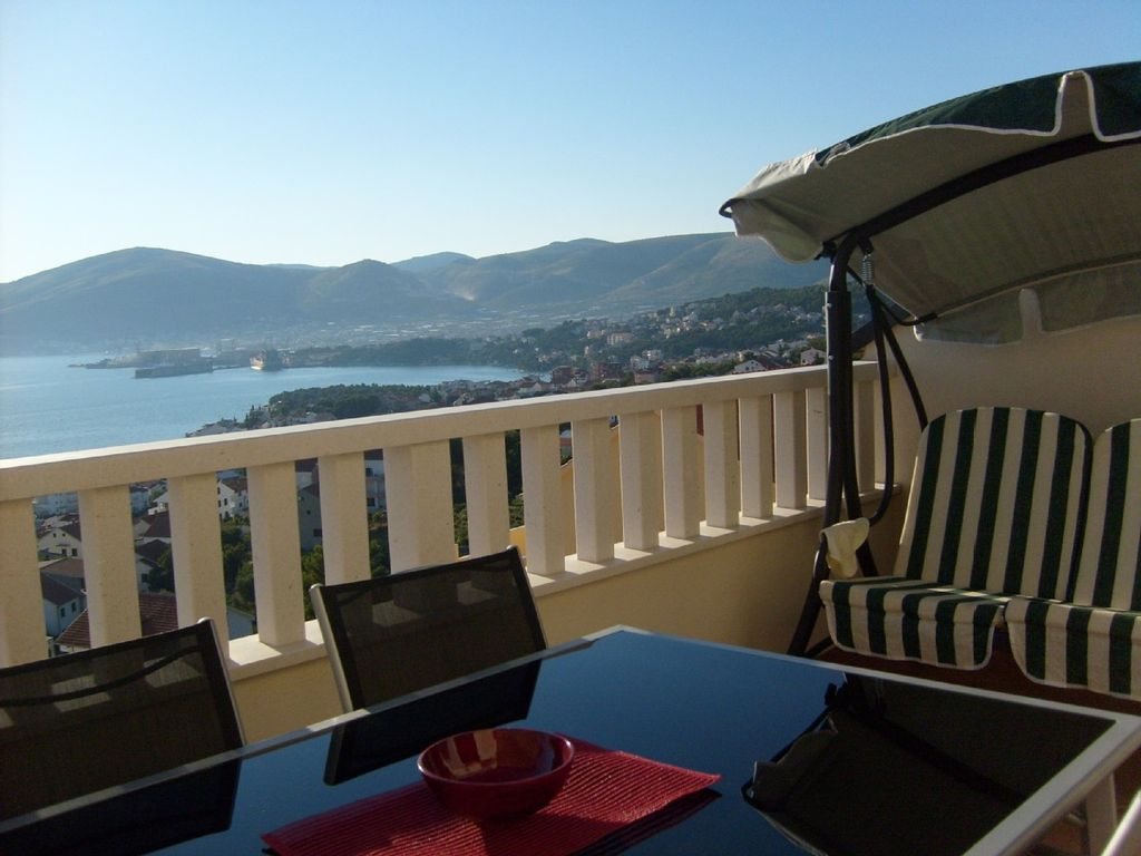 - Main balcony with 3 seater swing and sun lounger
