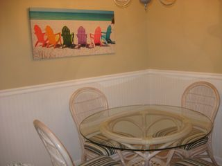 St. Simons Island condo photo - Enjoy your meals at the dining room table.