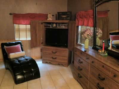 TV with DVD in credenza and dressers for for Large Bedroom