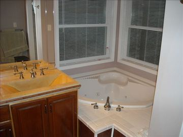 Jetted corner tub in large Master Bath with double sinks, shower, dressing table