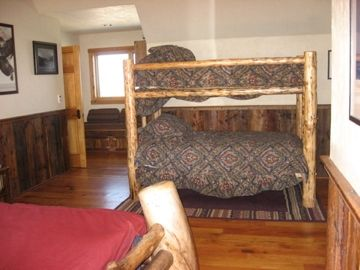 Bunk beds share an upstair bedroom w/ a king bed.