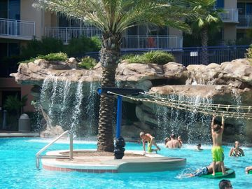 Okaloosa Island condo rental - pool rope climb and waterfall
